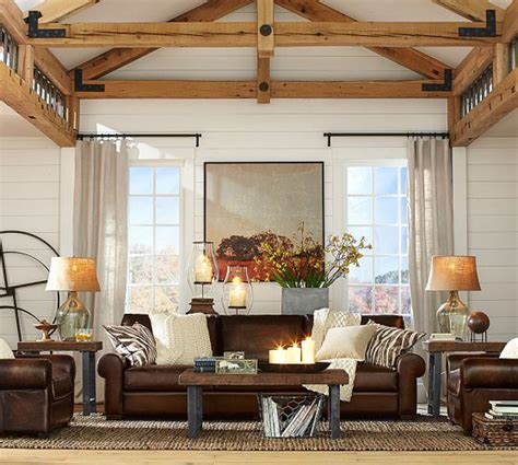 animal print rug and pillows living room family room masculine leather sofas cable knit and animal print