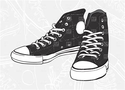Sepatu Balet Lipat classic black and white pair of sneakers royalty free
