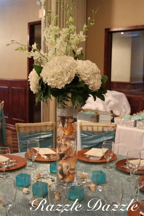 Themed Events N More Corpus Christi | centerpiece vase filled with sea shells beach theme