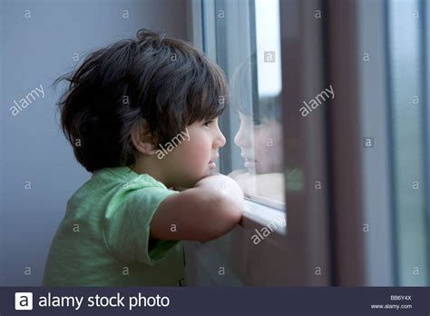 looking out from my lonely room lonely boy looking out of the window stock photo royalty free image 24124602 alamy