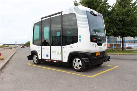 To Shuttle Or Not To Shuttlethat Is The Questions by Self Driving Buses Take To Roads Alongside Commuter
