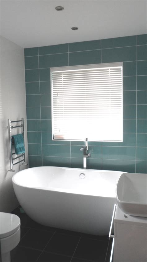 wooden blinds for bathrooms how to dress your bathroom windows with wooden blinds
