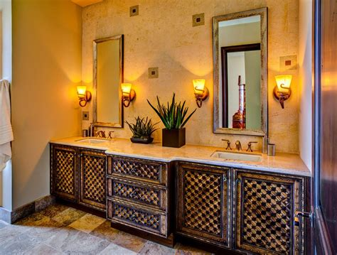 pretty bathroom vanity mediterranean with carved wall sconce