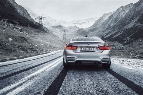 bmw in snow 2015 bmw m4 coupe silver paint snow tracks mountains
