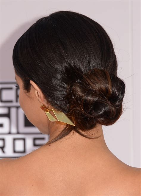selena gomez wearing a elegant low bunchignon hairstyle selena gomez twisted bun hair lookbook stylebistro