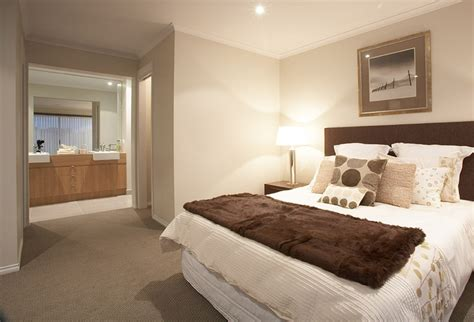 master bedroom featuring walk in robe and ensuite from the