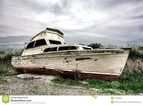 land boat old abandoned pleasure recreational boat on land stock