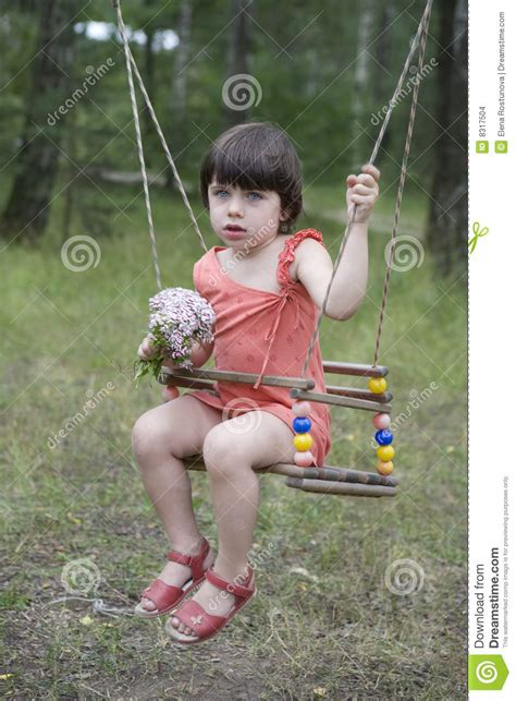 sitting swing litle cute girl sitting on swing stock photo image 8317504