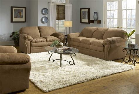 grey couch tan walls sofas white rugs glass table brown sofas grey wall