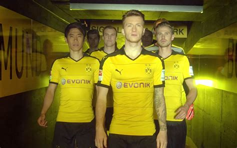 Evonik Jersey stand together in black and yellow borussia dortmund and