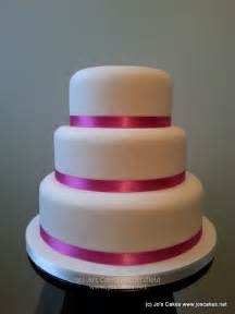 w075 3 tier plain iced hot pink and ivory wedding cake