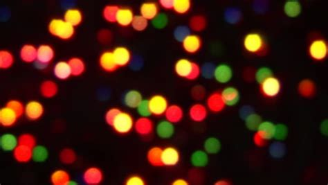 blurred colorful lights on black background with varying fade and twinkle patterns