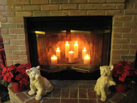 candles in fireplace grandiose brick wall exposed around fireplace with two sculpture cubs added candles in fireplace