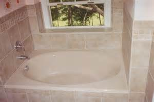 soaking tub with tiled walls