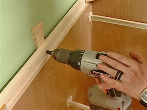 installing kitchen cabinets diy how to install a new cabinet how tos diy
