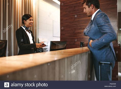 What Is Another Term Used For Desk Checking by Businessman Check In At Hotel Reception