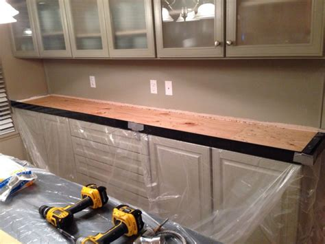 z counter forms kitchen remodel with white concrete