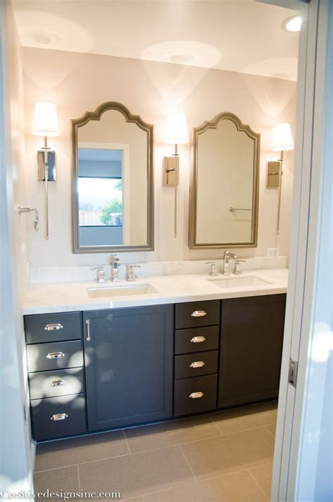 bathroom remodel using lowes cabinets and restoration