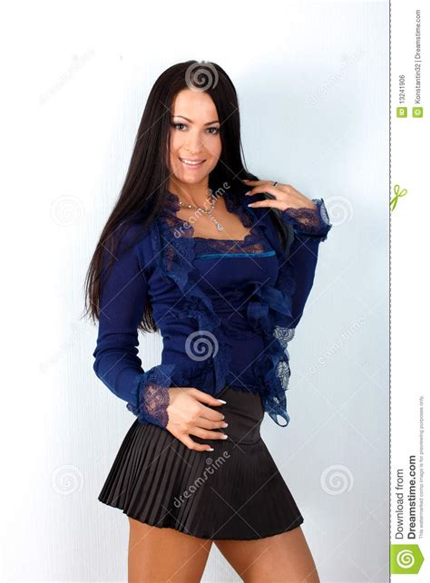 in blue shirt and black skirt stock photo