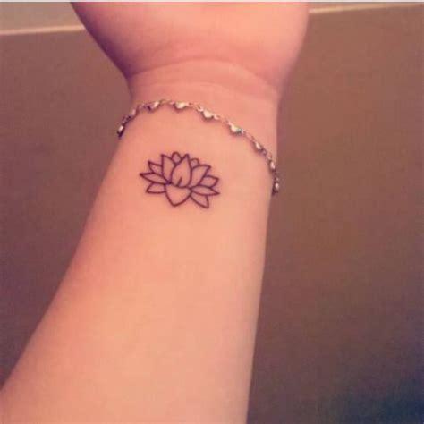 left wrist tattoo meaning lotus flower on melinas left wrist flower