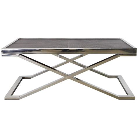 brown leather and stainless steel coffee table by