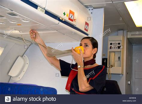 how to use bathroom in flight emergency in flight flight attendants a male flight attendant demonstrating how to