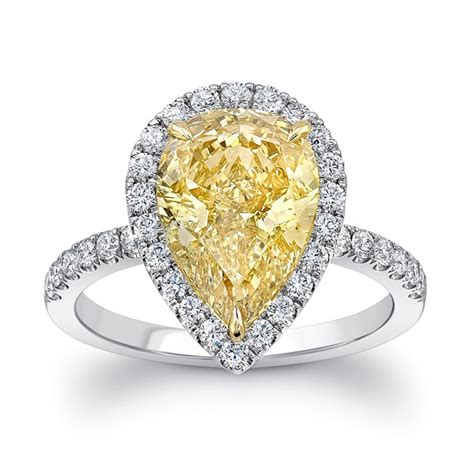 pear shaped fancy yellow halo engagement ring