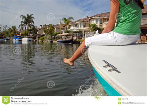 girl on front of boat a girl on the bow of a boat royalty free stock image