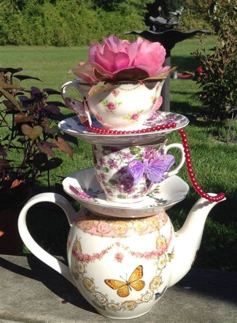 Table Centerpiece Ideas Stacked Floral Teapot Amp Teacup Centerpiece Teapot