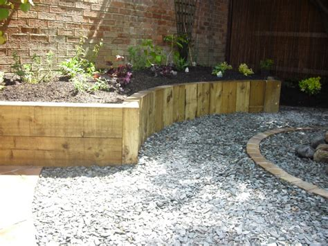 Vertical Oak Sleeper Retaining Walls Google Search Retaining Wall Garden Bed