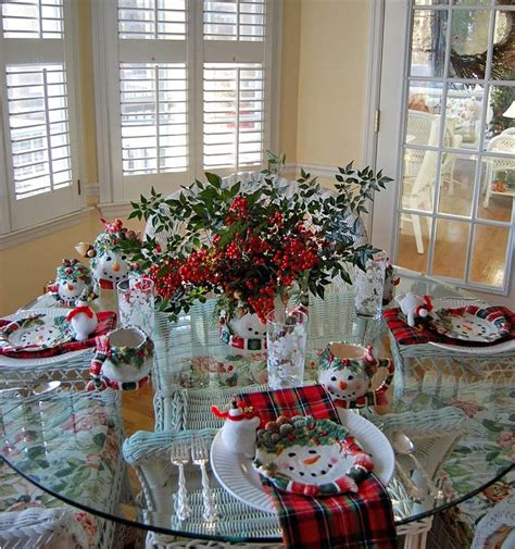 black and red christmas tablescapes winter tablescape with snowman plates plaid napkins and a nandina centerpiece
