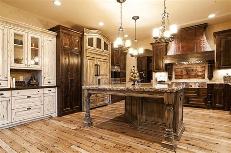 Light hickory floors with dark and cream cabinets. Love