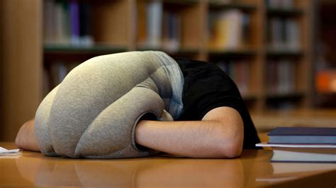 Ostrich Pillow by The Ostrich Pillow Mini Arms You With Comfort For Napping
