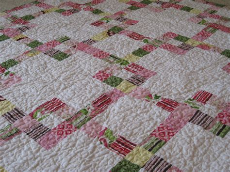 baby chain mail jelly roll quilt squares and triangles