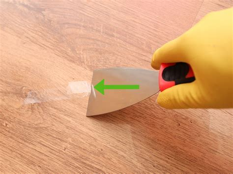 4 Ways to Remove Adhesive from a Hardwood Floor   wikiHow