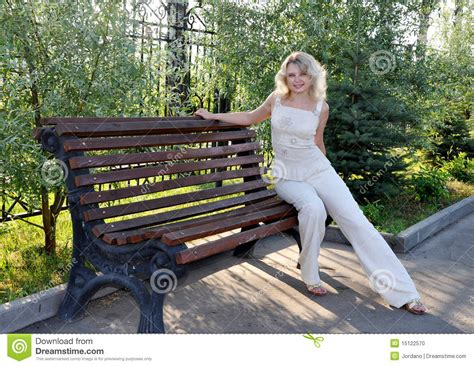 woman on bench young woman sitting on the bench stock photo image 15122570