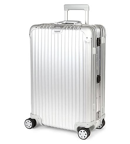 rimowa topas four wheeled suitcase 69cm selfridges com