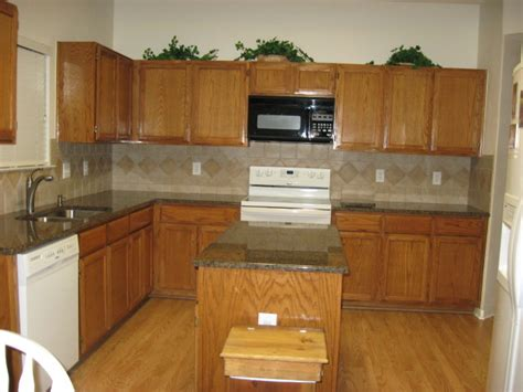 what color should i paint my kitchen with dark cabinets honey oak cabinets what color countertop what color