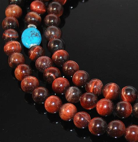 Mala Tiger Eye 8 Mm With Gold Vajra Ornament 8mm tigers eye mala designs