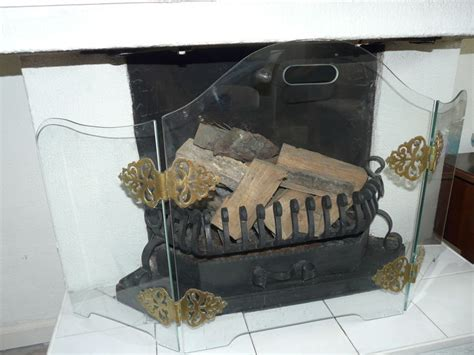 lovely fireplace screen made from heat resistant glass