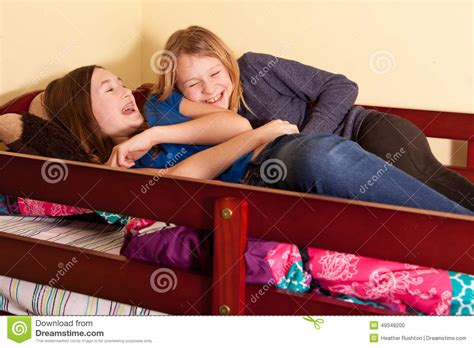 teen girls in bed teen girls laughing stock photo image 49348200