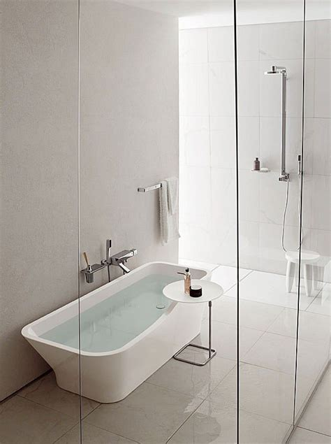separate shower  tub share space   glass wall