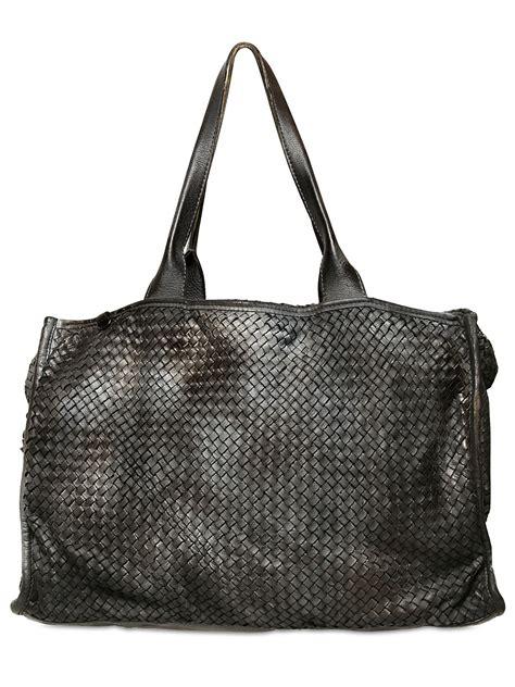 black leather weekender bag giorgio brato woven leather weekender bag in black for lyst