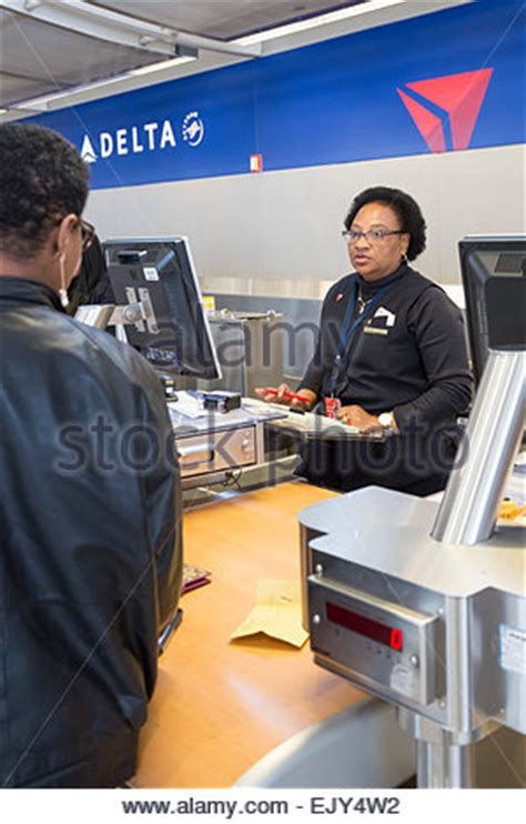 Delta Background Check Romulus Michigan A Delta Air Lines Ticket Checks In A Stock Photo Royalty