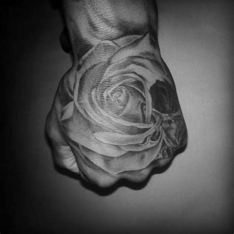 black and grey rose tattoo on hand iva chavez
