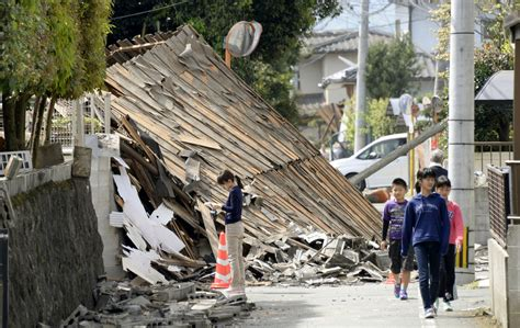 earthquake japan aftershocks widespread damage after deadly japan