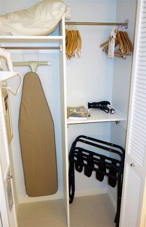 there s a whole universe of closet space hidden under this bed curbed photo tour of a standard room at the disney world swan