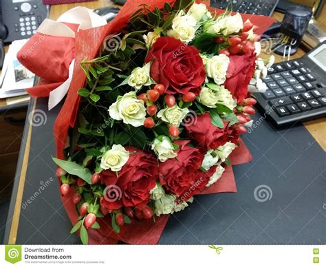 flowers for office desk bouquette of flowers on the desk stock photo image 64002883