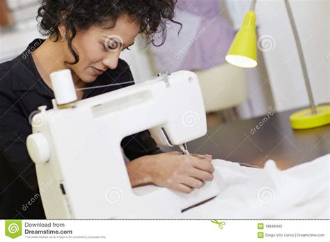 design clothes sewing fashion designer with sewing machine stock photography