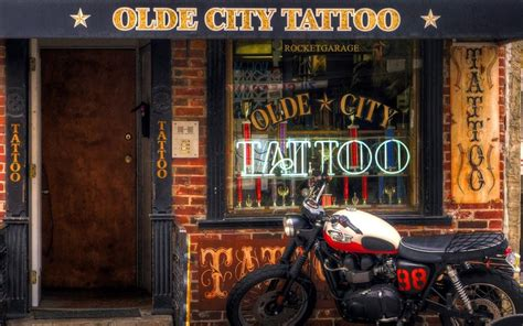 tattoo cafe triumph cafe racer outside a shop storefronts